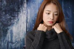 Deprimierte asiatische Frau Lizenzfreie Stockbilder