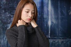 Deprimierte asiatische Frau Stockfoto