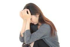 Deprimierte asiatische Frau Lizenzfreies Stockbild