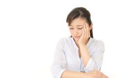 Deprimierte asiatische Frau Stockbilder