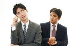 Deprimierte asiatische Geschäftsmänner Lizenzfreies Stockbild