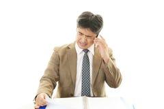 Deprimierte asiatische Geschäftsmänner Lizenzfreies Stockfoto