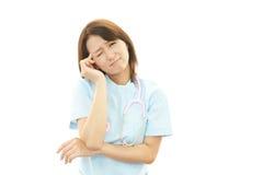 Deprimierte asiatische weibliche Krankenschwester Stockbilder
