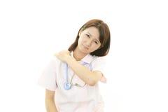 Deprimierte asiatische weibliche Krankenschwester Lizenzfreies Stockbild