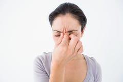 Deprimierte die Stirn runzelnde Frau Lizenzfreie Stockbilder