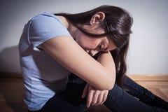 Deprimierte Frau der Krise Stockfoto