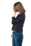 Deprimierte Frau, die ihr Gesicht versteckt Lizenzfreies Stockfoto