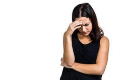 Deprimierte Frau mit der Hand auf Kopf Stockbild