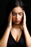 Deprimierte Frau mit Migränen Stockbild