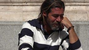 Deprimierte hübsche spanische Person Stockbilder