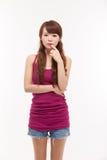 Deprimierte junge asiatische Frau. Stockfotos