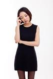 Deprimierte junge asiatische Frau Stockfotografie