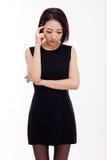 Deprimierte junge asiatische Frau Lizenzfreie Stockfotografie