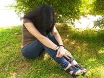 Deprimierte junge Frau Stockfoto