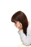 Deprimierte junge japanische Frau Lizenzfreie Stockfotografie