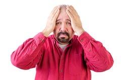 Deprimierte Mitte alterte Mann mit Kopf in den Händen Stockfoto