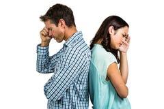 Deprimierte Paare, die zurück zu Rückseite stehen Lizenzfreies Stockbild