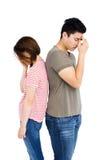 Deprimierte Paare, die zurück zu Rückseite stehen Lizenzfreie Stockbilder