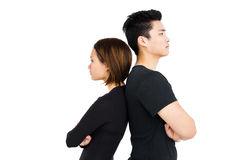 Deprimierte Paare, die zurück zu Rückseite stehen Lizenzfreie Stockfotos