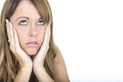 Deprimierte und unglückliche junge Frau Lizenzfreie Stockfotografie