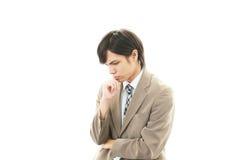Deprimierter asiatischer Geschäftsmann. Lizenzfreie Stockfotos