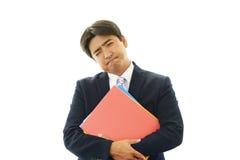 Deprimierter asiatischer Geschäftsmann. Lizenzfreie Stockbilder