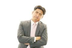 Deprimierter asiatischer Geschäftsmann. Stockfoto