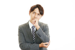 Deprimierter asiatischer Geschäftsmann Lizenzfreie Stockfotografie