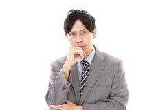 Deprimierter asiatischer Geschäftsmann Stockfotos
