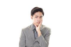 Deprimierter asiatischer Geschäftsmann Stockbilder