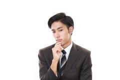 Deprimierter asiatischer Geschäftsmann Lizenzfreies Stockbild
