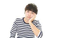 Deprimierter asiatischer Mann Lizenzfreie Stockbilder
