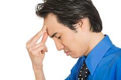 Deprimierter des Headshot trauriger, allein, enttäuschter düsterer junger Mann Stockfotografie