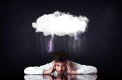 Deprimierter Geschäftsmann, der unter einer Wolke sitzt Lizenzfreie Stockbilder