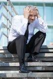 Deprimierter Geschäftsmann. Stockbild
