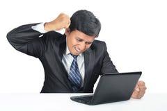 Deprimierter indischer junger Geschäftsmann Lizenzfreie Stockbilder