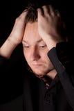 Deprimierter junger Geschäftsmann Lizenzfreie Stockbilder