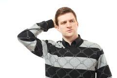 Deprimierter junger Mann, der seinen Kopf anhält Stockfotos