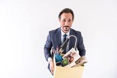 Deprimierter reifer arbeitsloser Mann fühlt sich umgekippt Stockfotografie