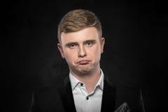 Deprimierter stattlicher junger Mann Stockbild
