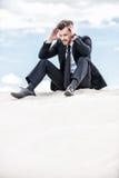 Deprimierter und verwirrter Geschäftsmann Stockbilder