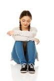 Deprimiertes jugendlich Frauensitzen Lizenzfreie Stockfotografie
