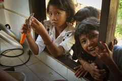 Deprived children in the kitchen at lunch time. Unknown children in the kitchen at lunch time at school by project Cambodian Kids Care to help deprived children Royalty Free Stock Image