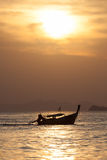 Depth of field Lonely boat on the beach at sunset time. Stock Photos