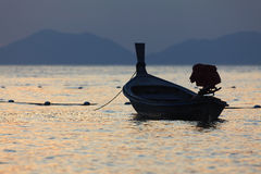 Depth of field Lonely boat on the beach at sunset time. Stock Photography