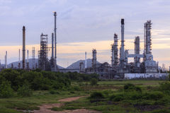 Depth of field the Oil refinery with Steam at Sunrise time. Stock Photography