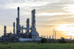 Depth of field the Oil Refinery with steam at Sunrise time. Royalty Free Stock Images