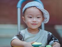 Depth of Field Photo of Boy Wearing Blue Cap stock photography