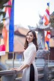 Depth of Field Photo of Woman Wearing White Dress Standing Near Flag Pole Royalty Free Stock Images