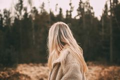 Depth of Field Photography of Woman Wearing White Coat Near Trees stock images
